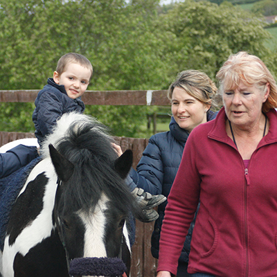 Image of volunteers at Clwyd Special Riding Centre, click on the photo to go to the volunteer page